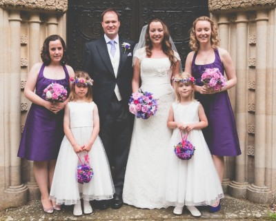 Bride and groom, bridesmaids and flower girls
