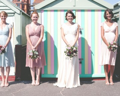 Hove beach huts with bride and bridesmaids
