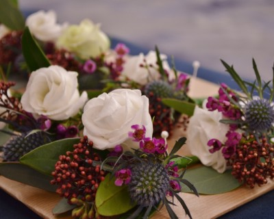Winter buttonholes, thistle, waxflower, skimmia