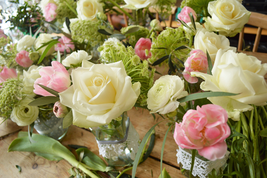 wedding jam jar arrangements with roses and tulips