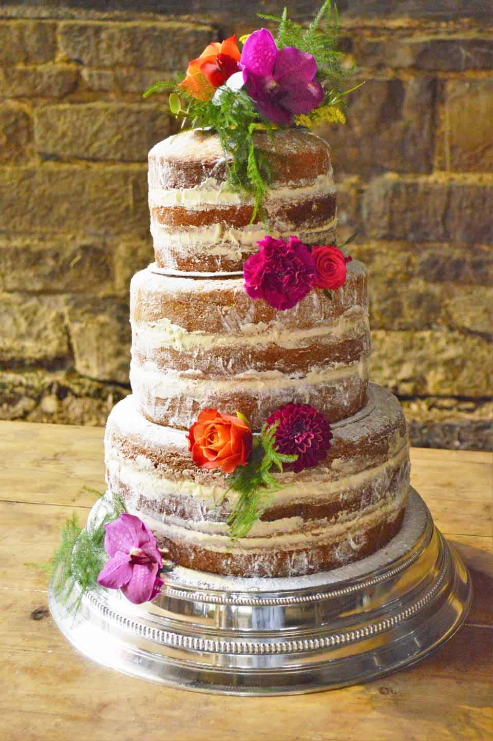naked cake sussex orchids dahlias roses and fern