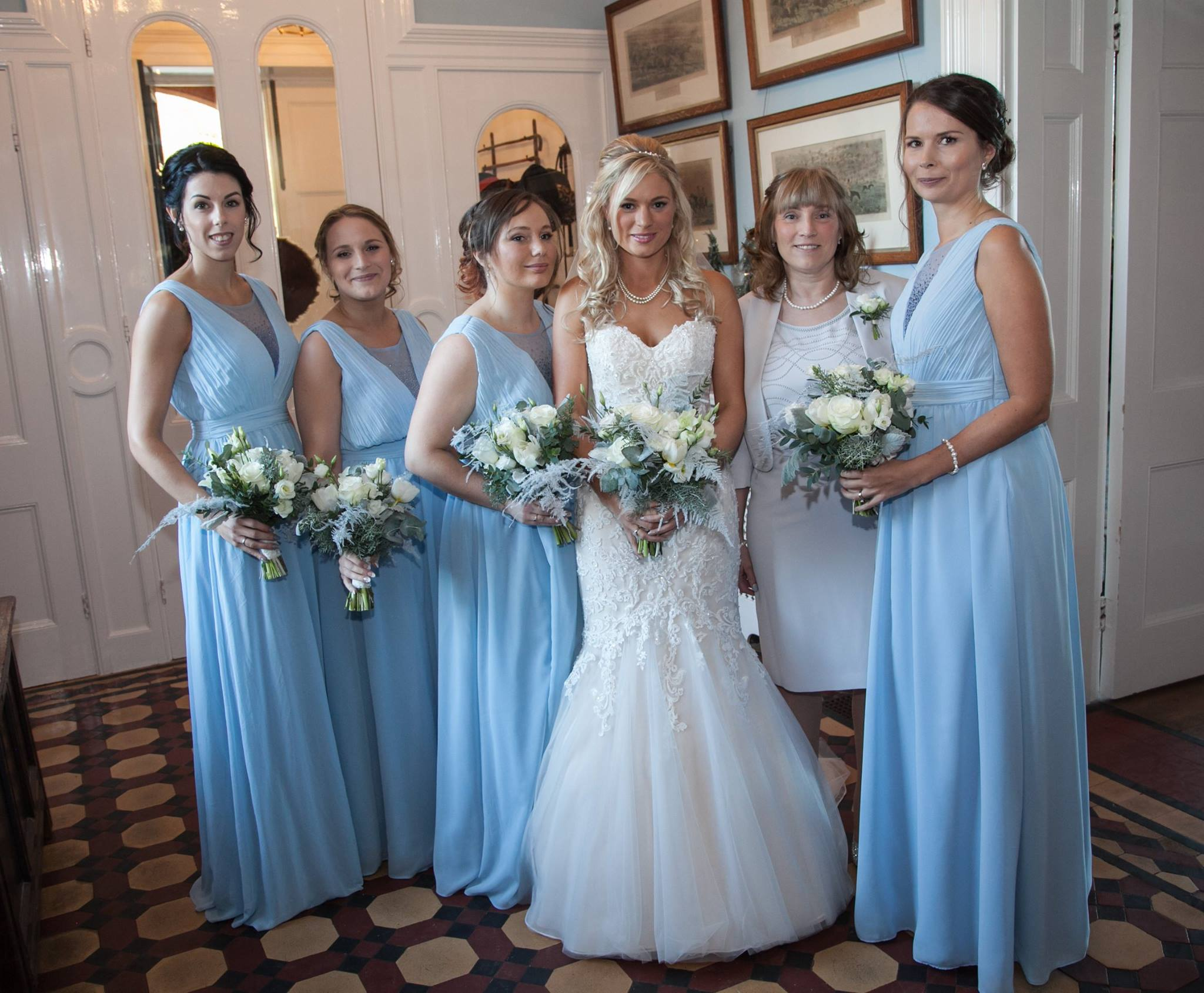 Winter wedding flowers sussex. Bride and bridesmaids in frozen ice blue dresses