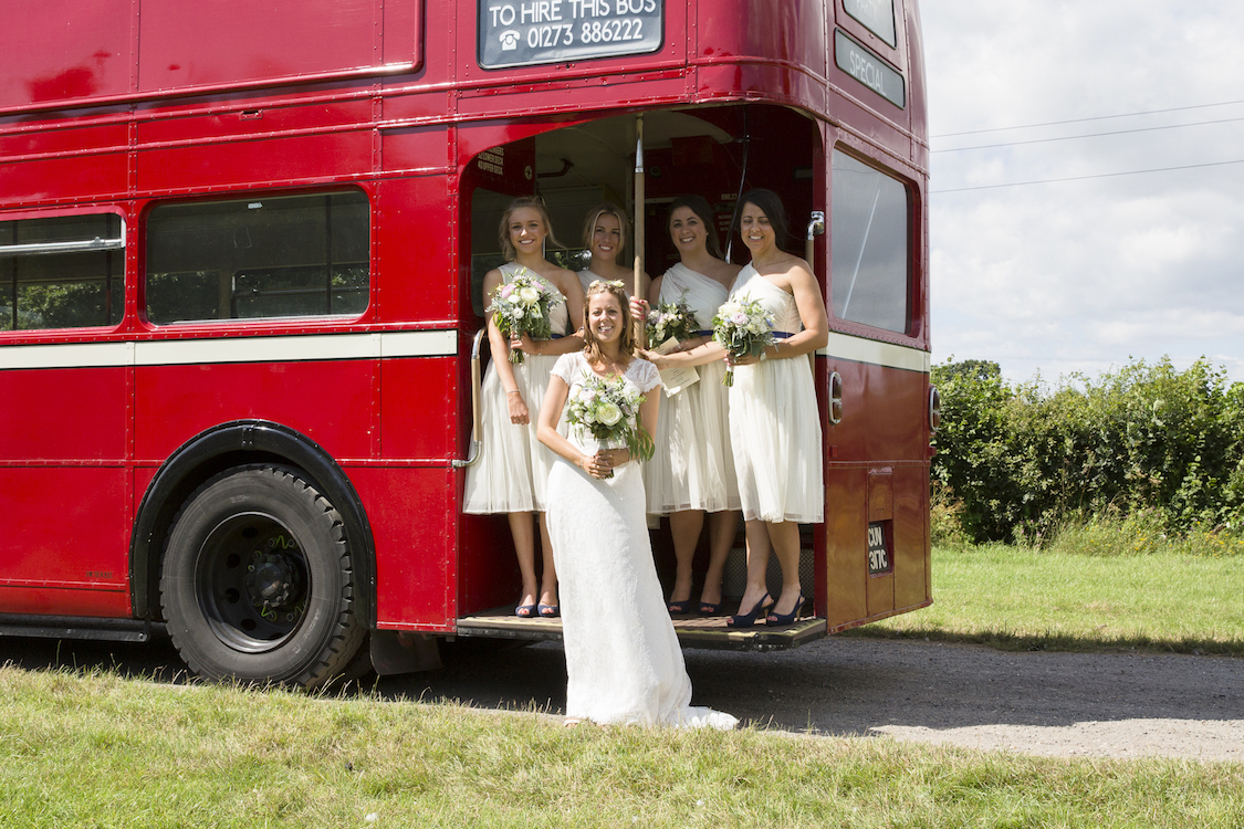 bride and bridesmaids with vintage red bus