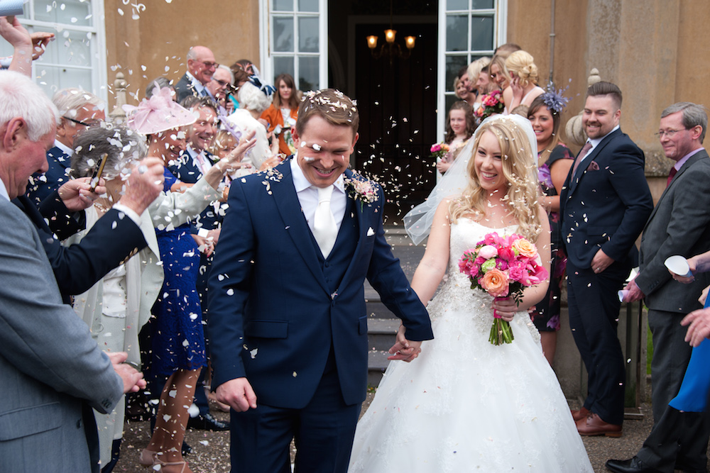 Nonsuch mansion april wedding, bride and groom and confetti