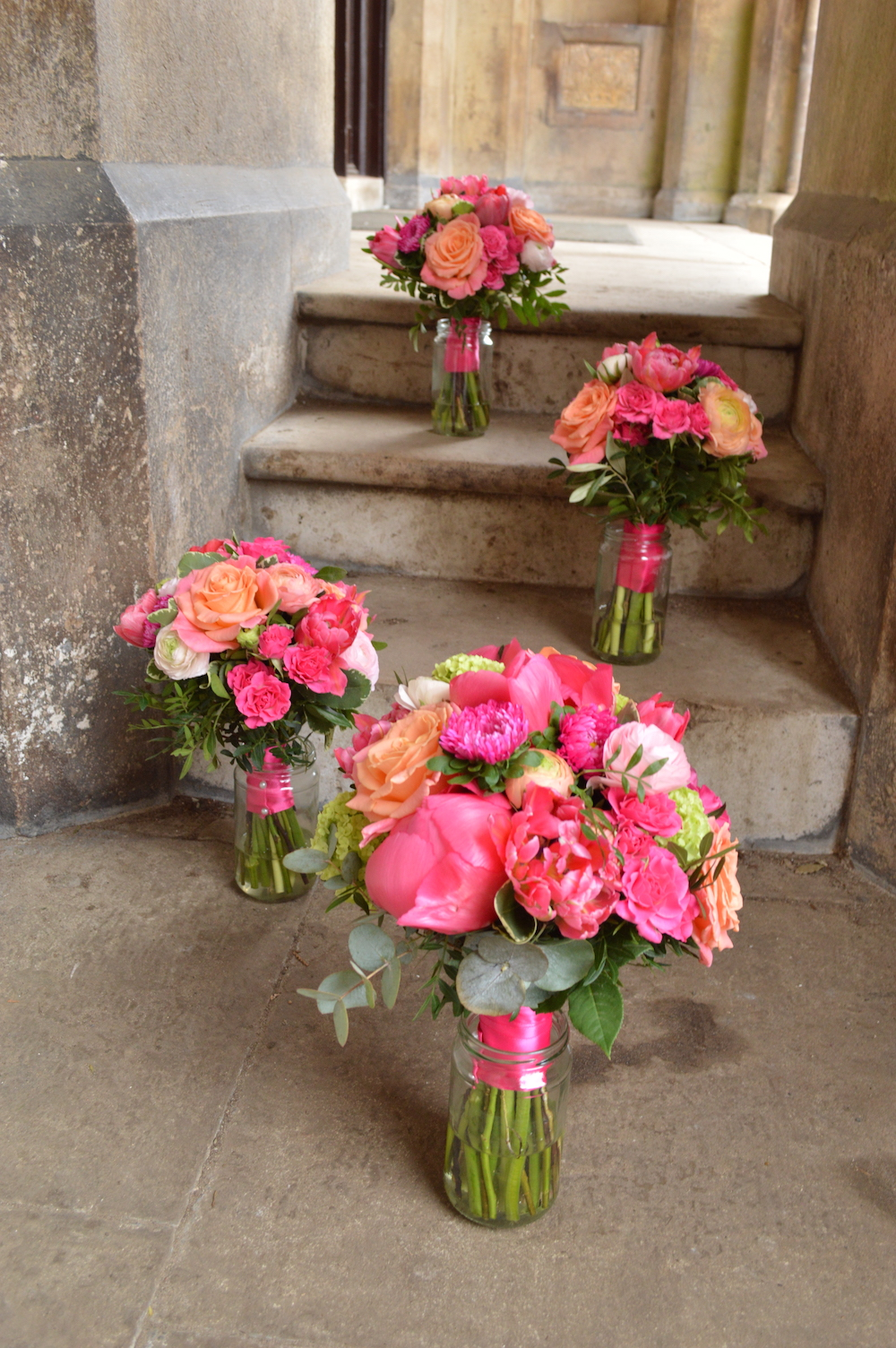bride and bridesmaids bouquets, hot pink and peach