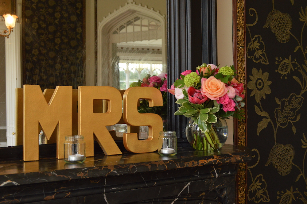 mr and mrs mantelpiece decor with flowers at nonsuch mansion