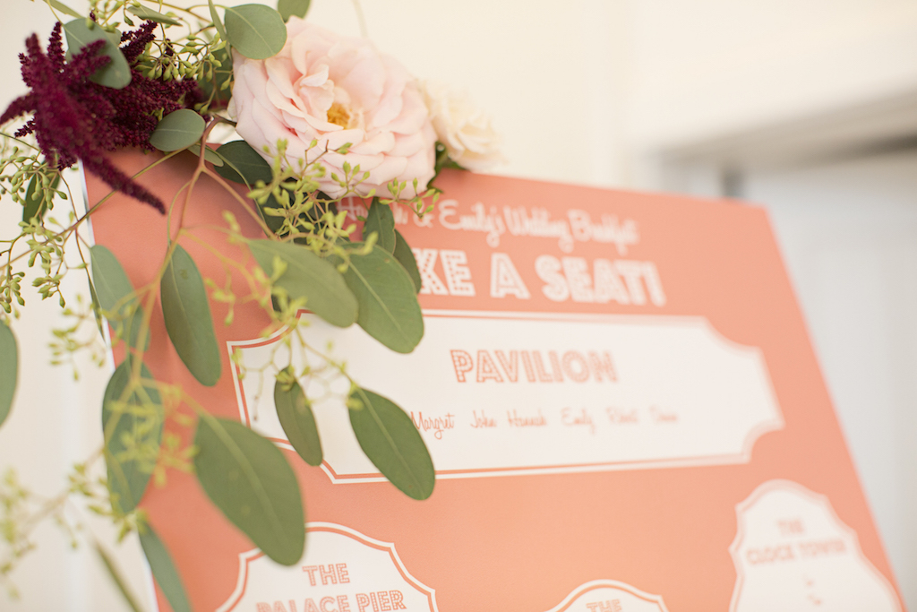 salmon pink table plan with flowers