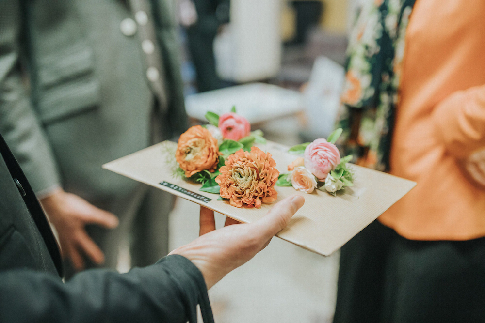 orange ranunculus buttonholes, Brighton wedding