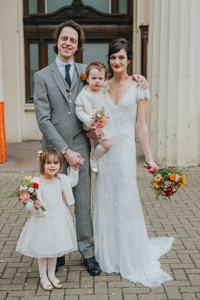 bride and groom and little daughters, family wedding shot Brighton