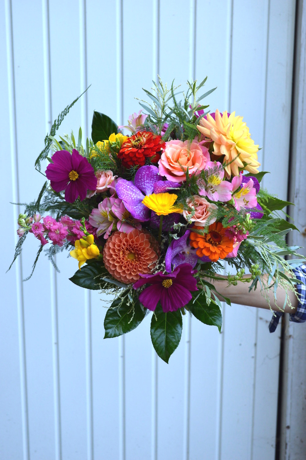 hot pink, peach and coral bridal bouquet, tropical leaf and orchid