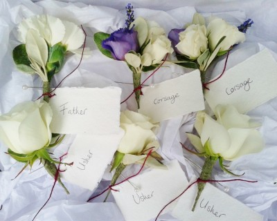 Akito rose buttonholes