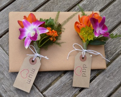 Corsages with orange, green and pink flowers - Surrey