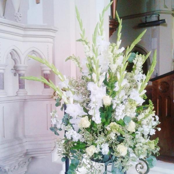 White wedding arrangement with gladioli, roses and stocks