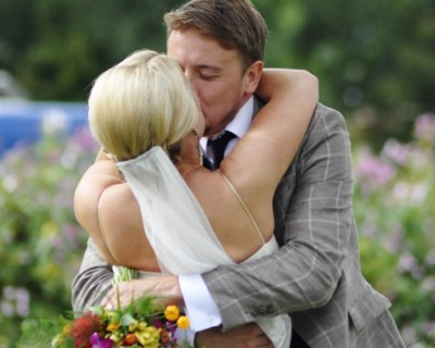 Bride and groom first kiss. Wedding flowers. Bridal bouquet. Sussex wedding flowers.