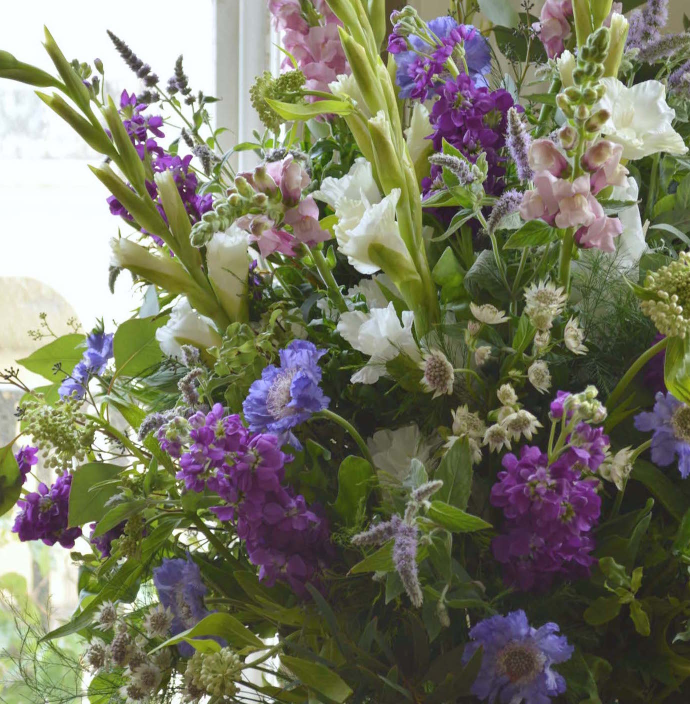 purple, blue and lilac pedestal arangement