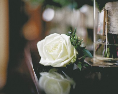 White rose buttonhole at The Claremont Hove