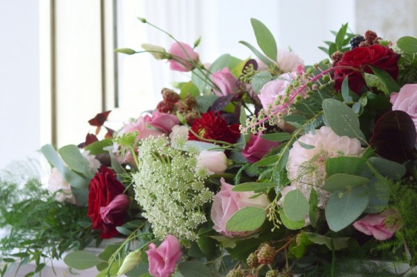 dusky pink and burgundy wedding mantelpiece arrangement