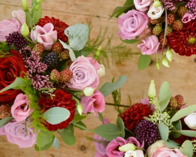 bridesmaids bouquets with blackberries, roses and eucalyptus