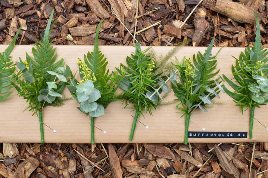all green buttonholes rustic