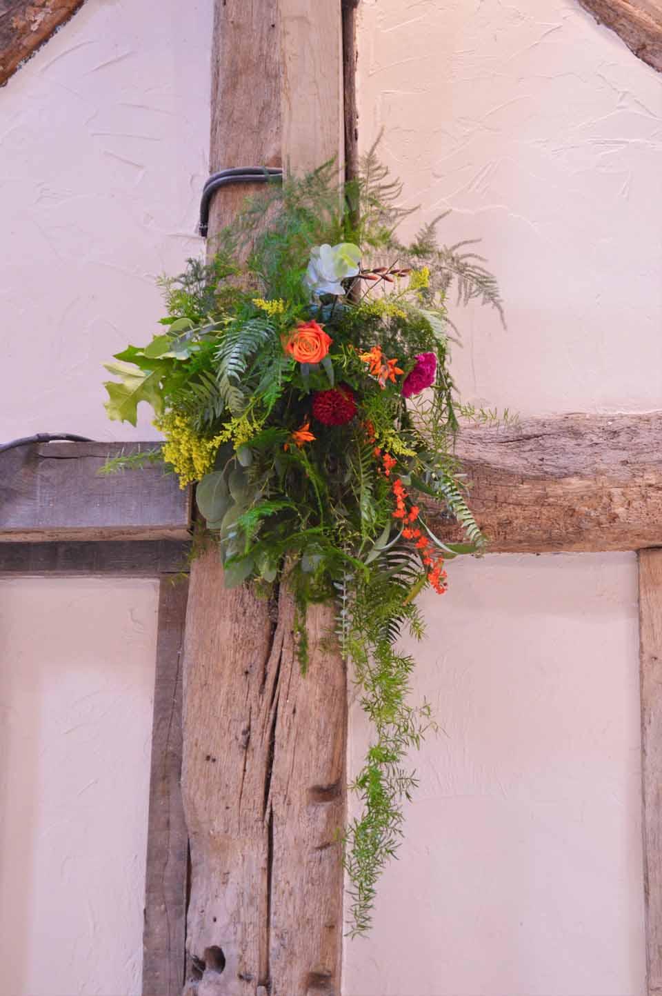 hanging flowers barn wedding