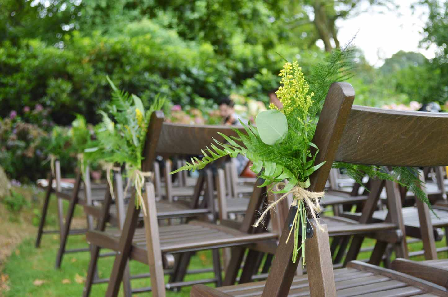 green natural rustic pew ends with fern and eucalyptus