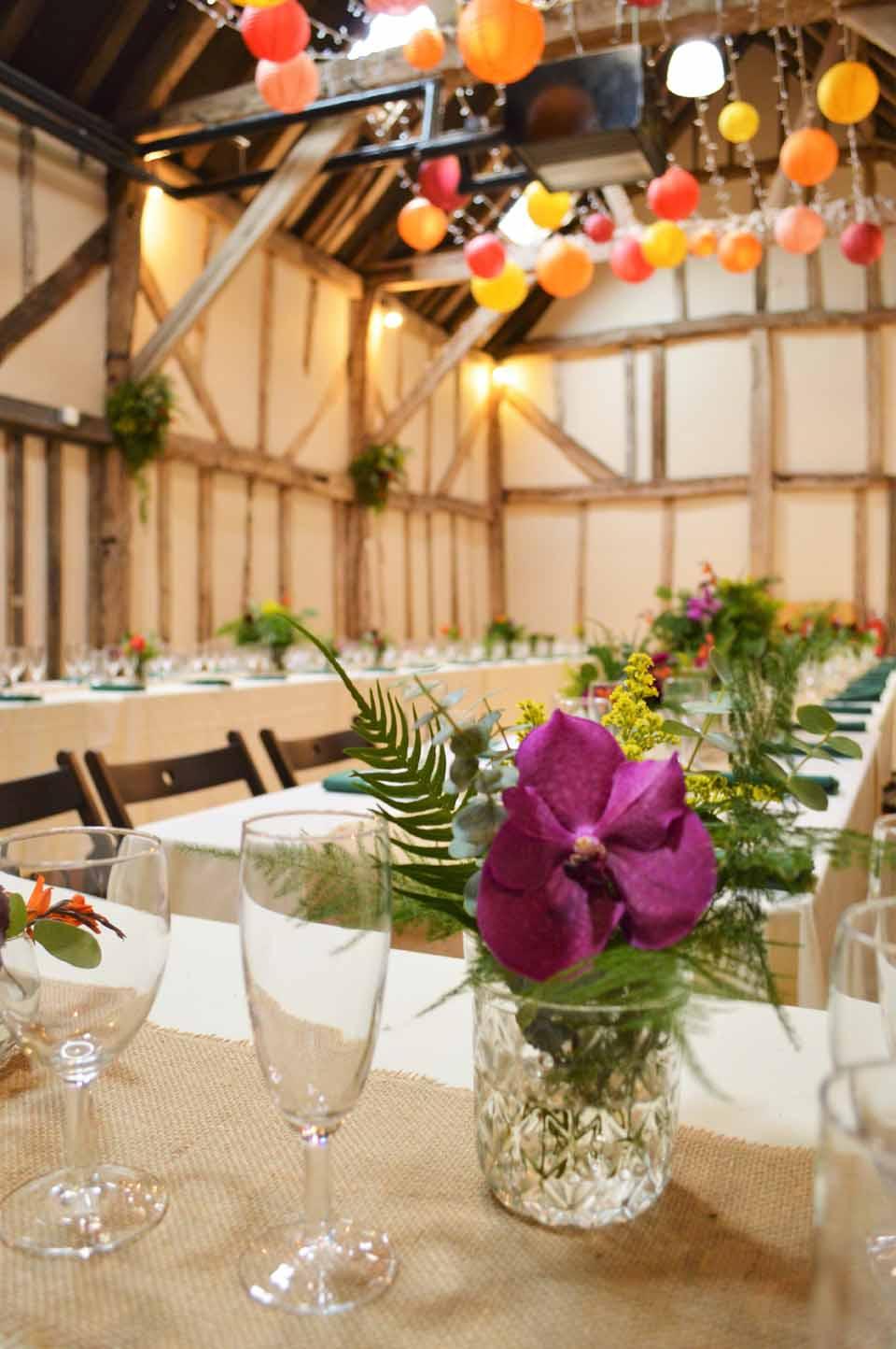 patricks barn chiddinglye wedding lanterns and flowers not your average i do