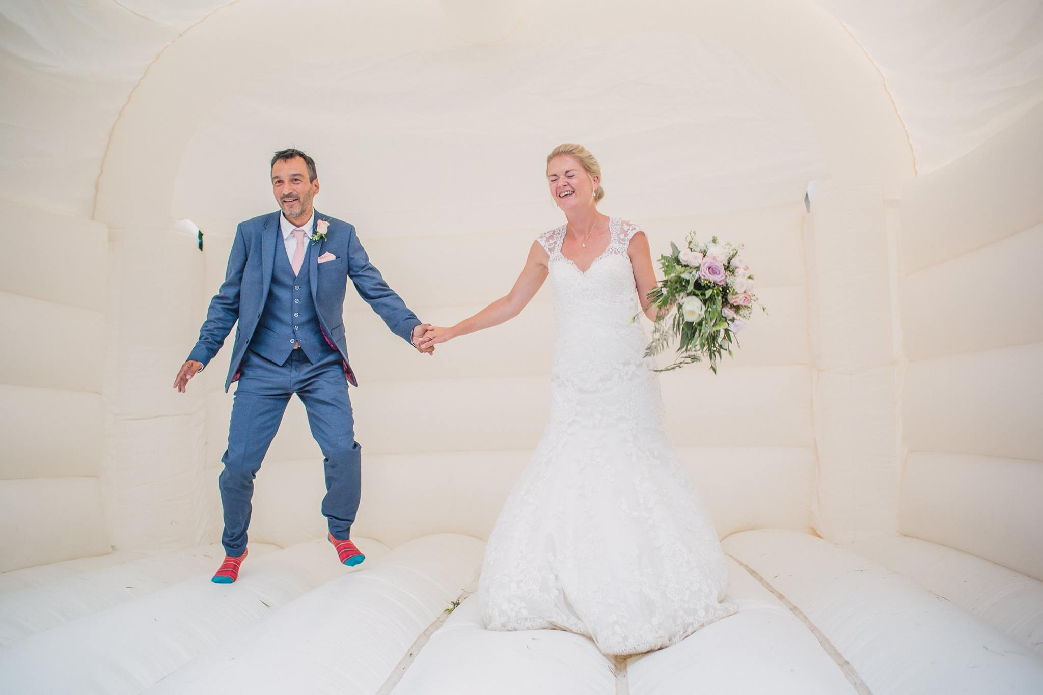 bride and groom bouncy castle, fun wedding