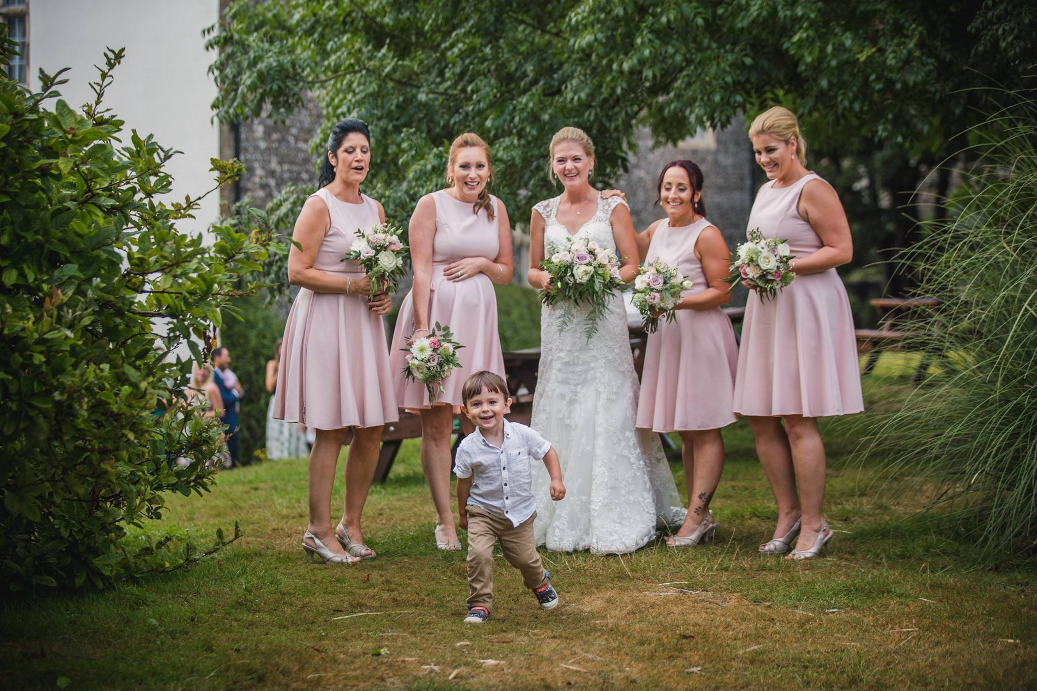 blush bridesmaids dresses and flowers