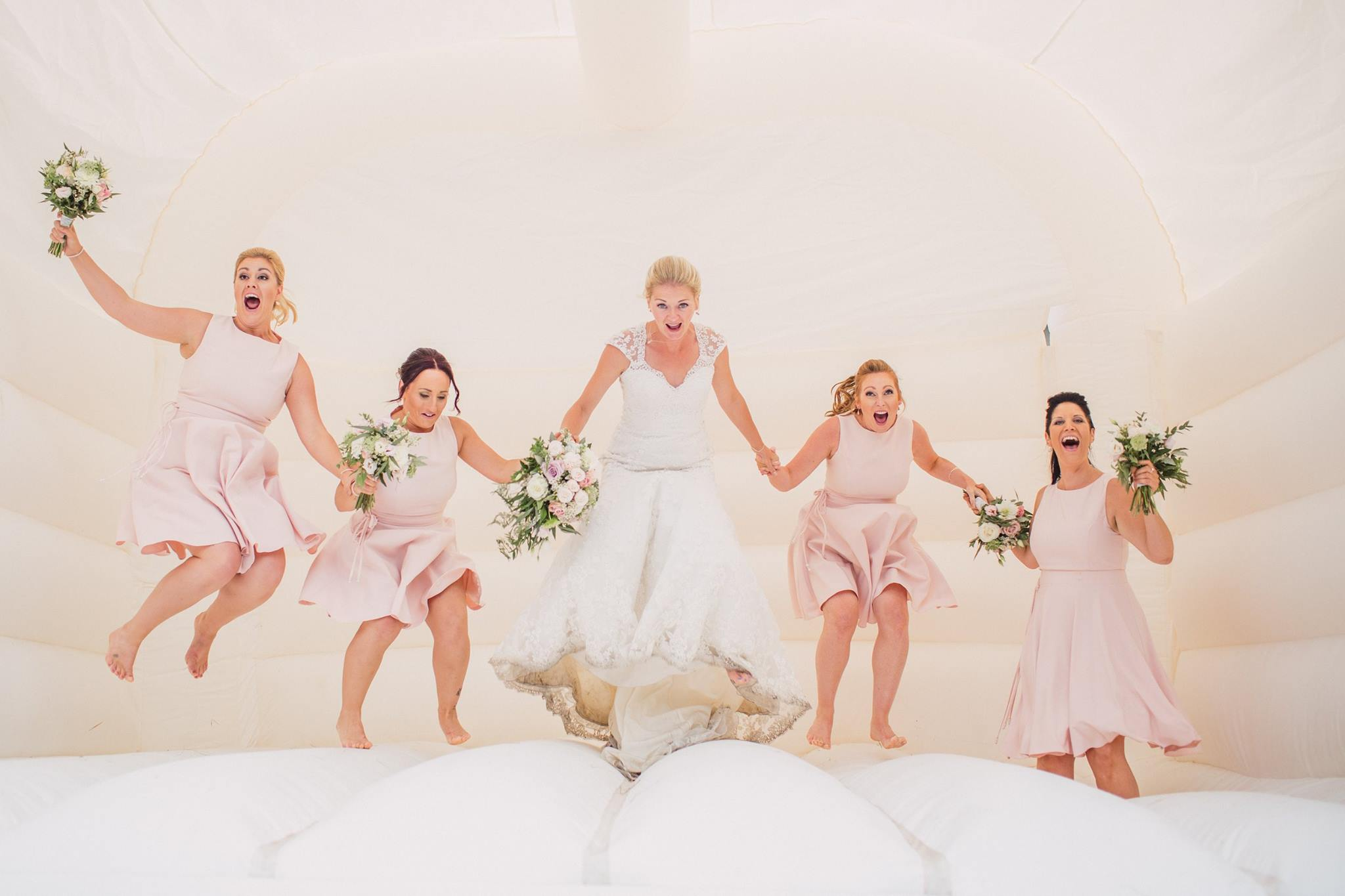 bride and bridesmaids bouncy castle
