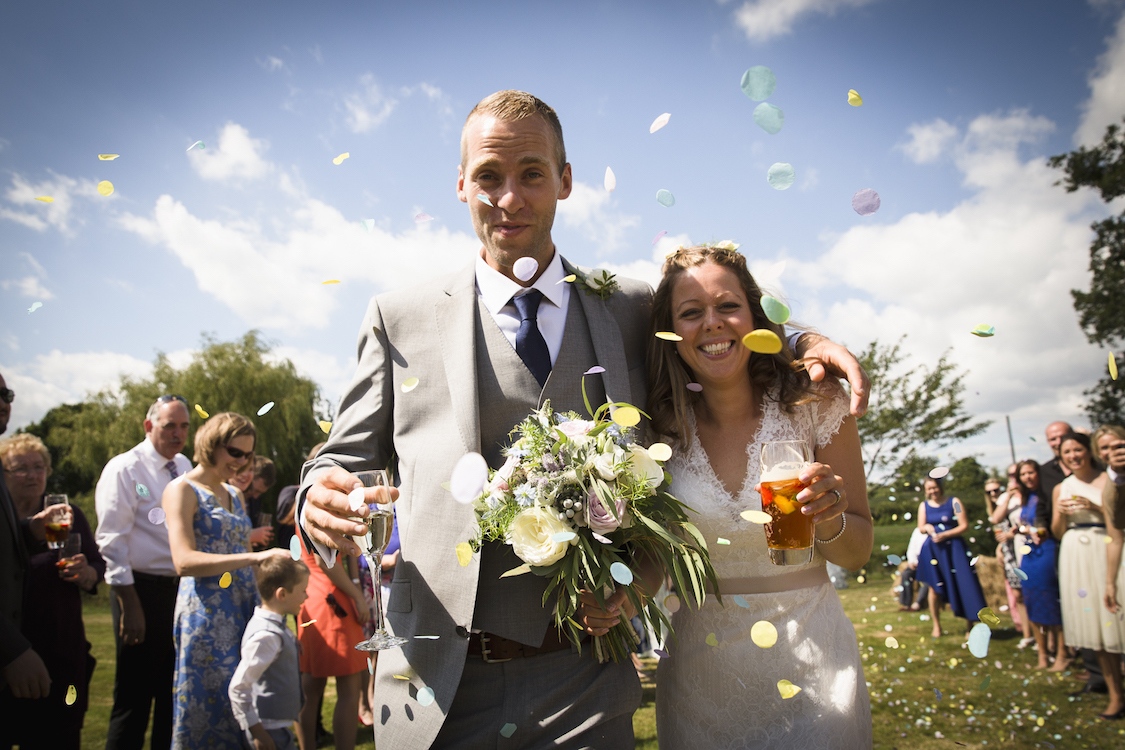 festival wedding bride and groom with confetti