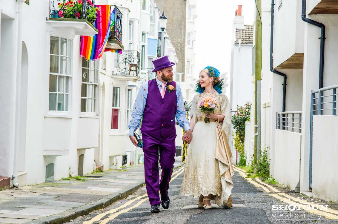 pride brighton wedding, groom in purple suit