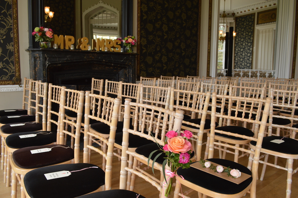 wedding ceremony at nonsuch mansion with flowers