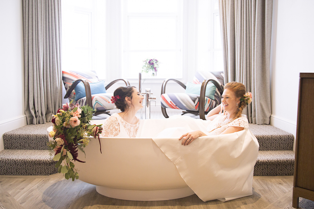 same sex wedding, brides in brighton harbour hotel honeymoon suite