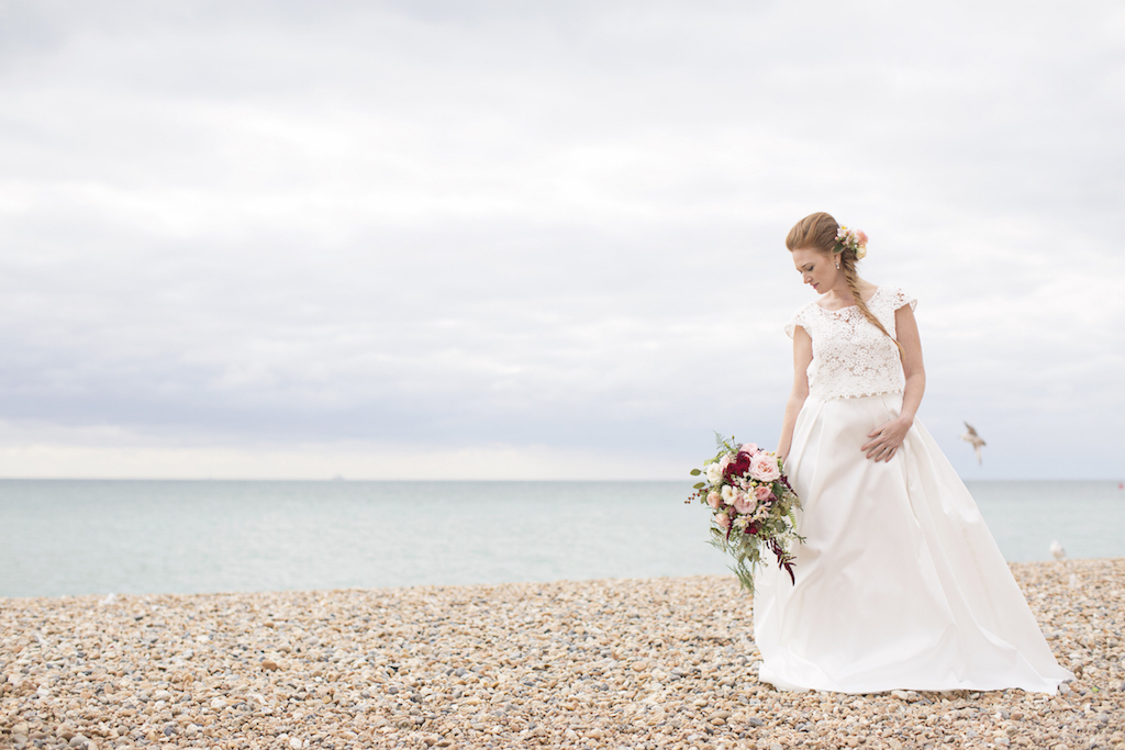 bride on brighton beach with flowers