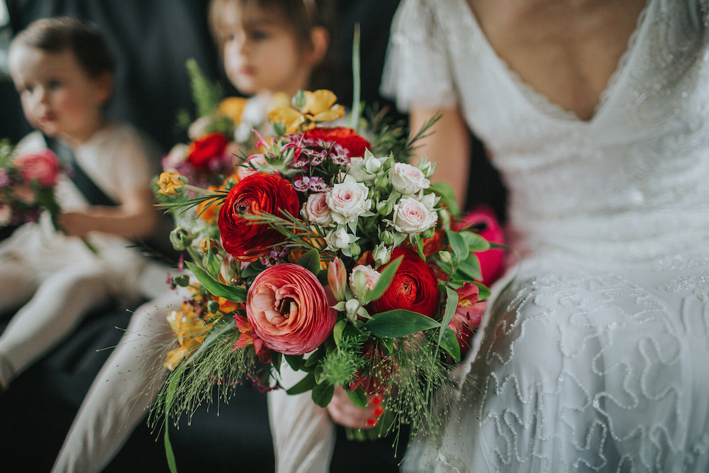 red, orange and green spring wedding bouquet by Bette Rose Brighton
