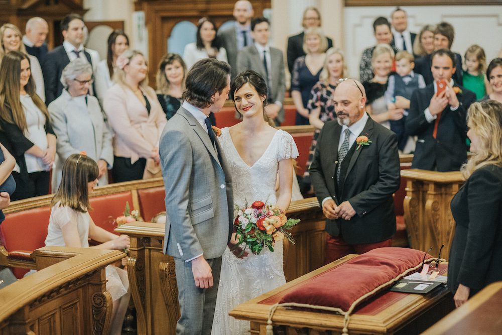 brighton town hall council chamber wedding, bride and groom and colourful flowers
