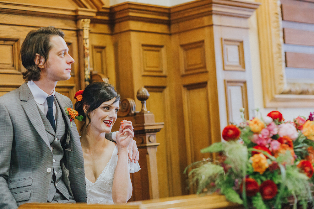 Bride and groom in the council chamber wedding ceremony room