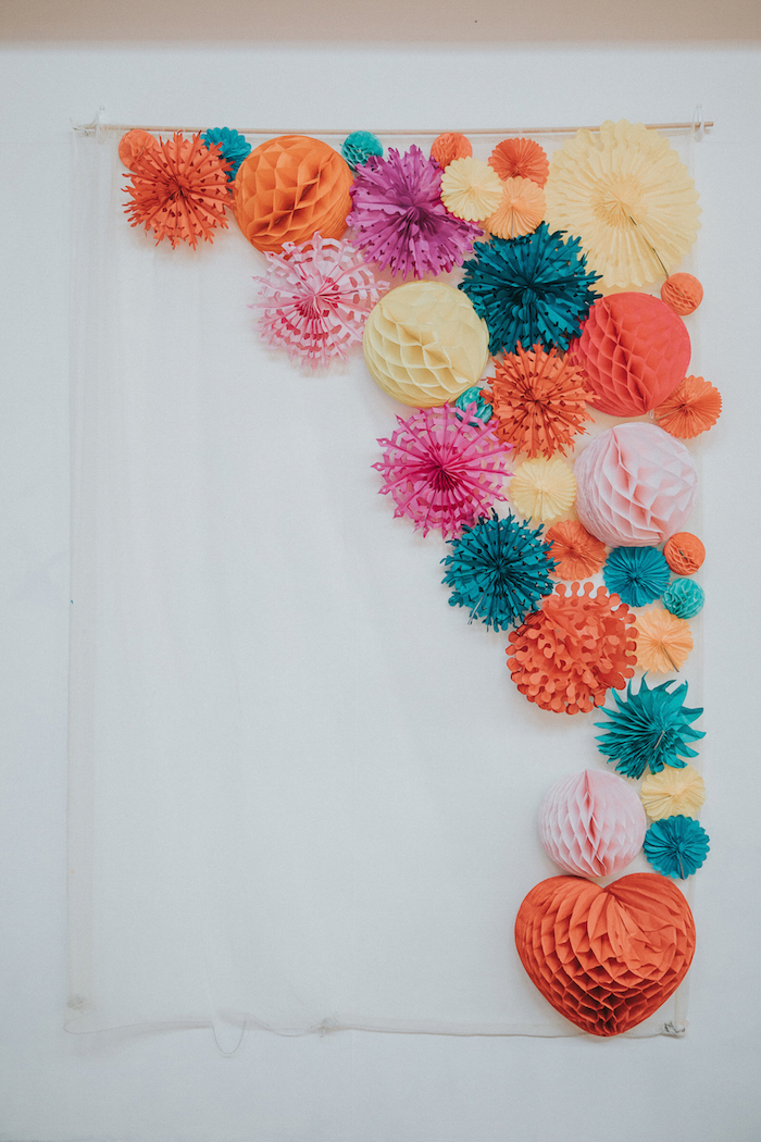 paper fan wall hanging, orange red blue and pink