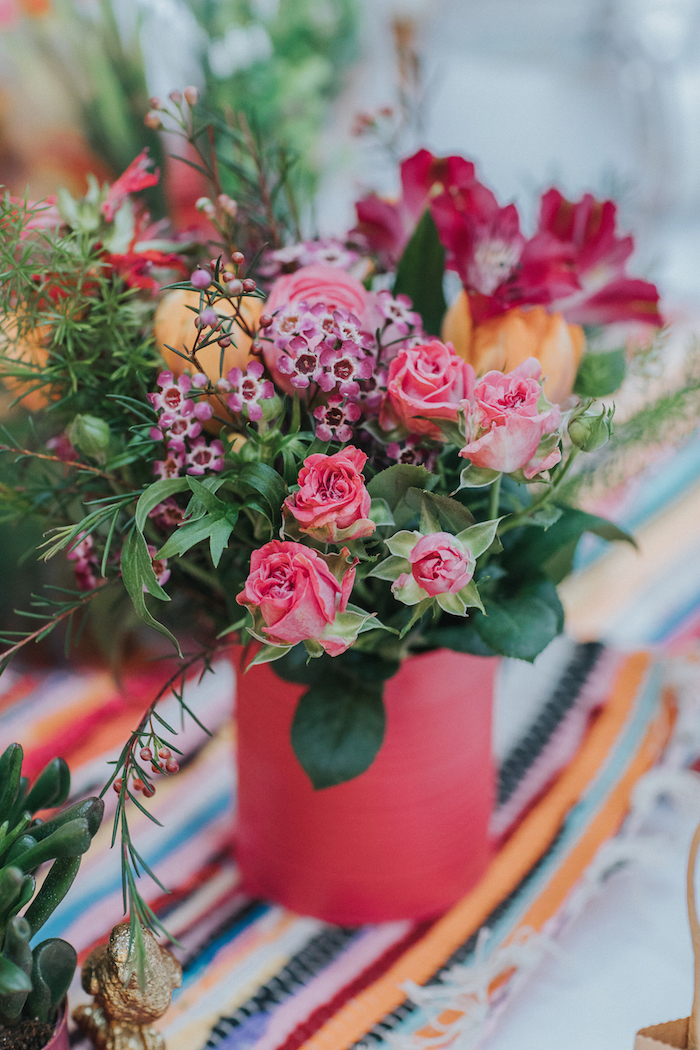 wedding table flowers in coloured tins