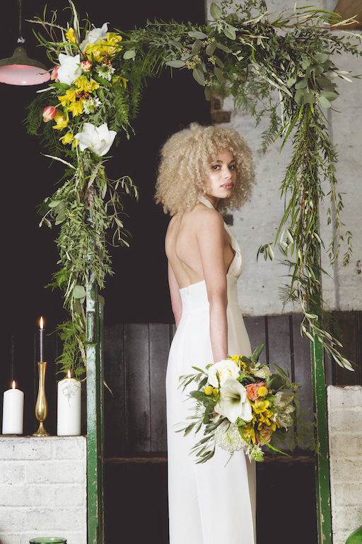 greenery wedding arch with yellow flowers, Sussex florist