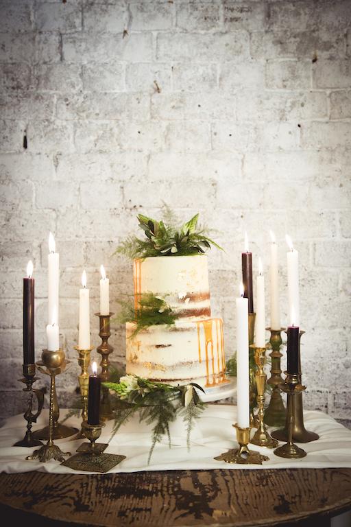 naked wedding cake with candle decoration