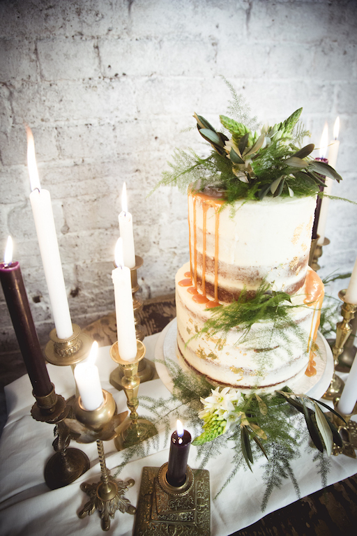 wedding cake table, candles and greenery