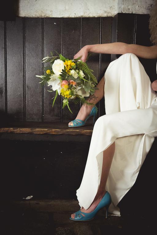 alternative wedding inspiration, wedding jumpsuit, turquoise shoes, yellow bouquet