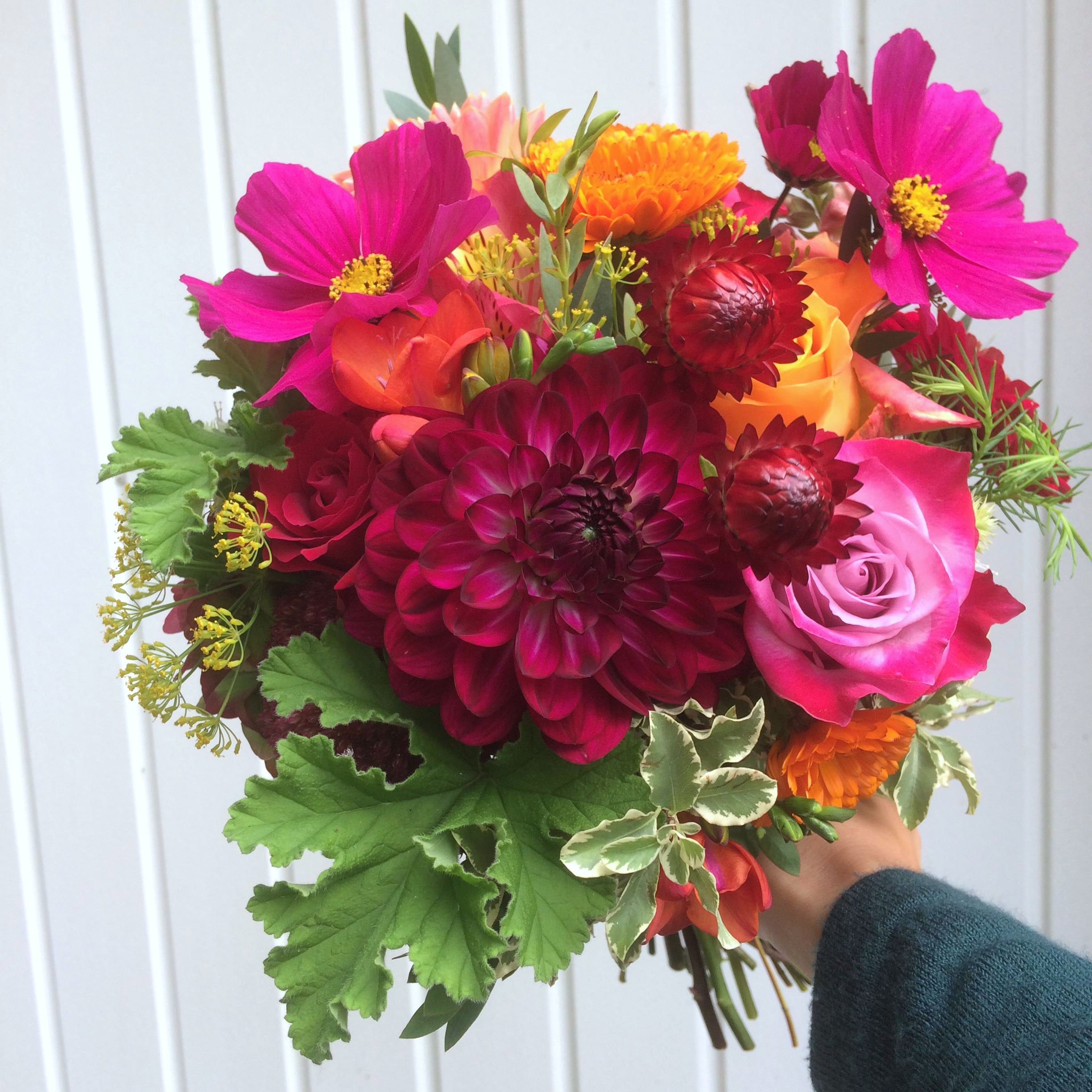deep pink dahlia and orange bridal bouquet