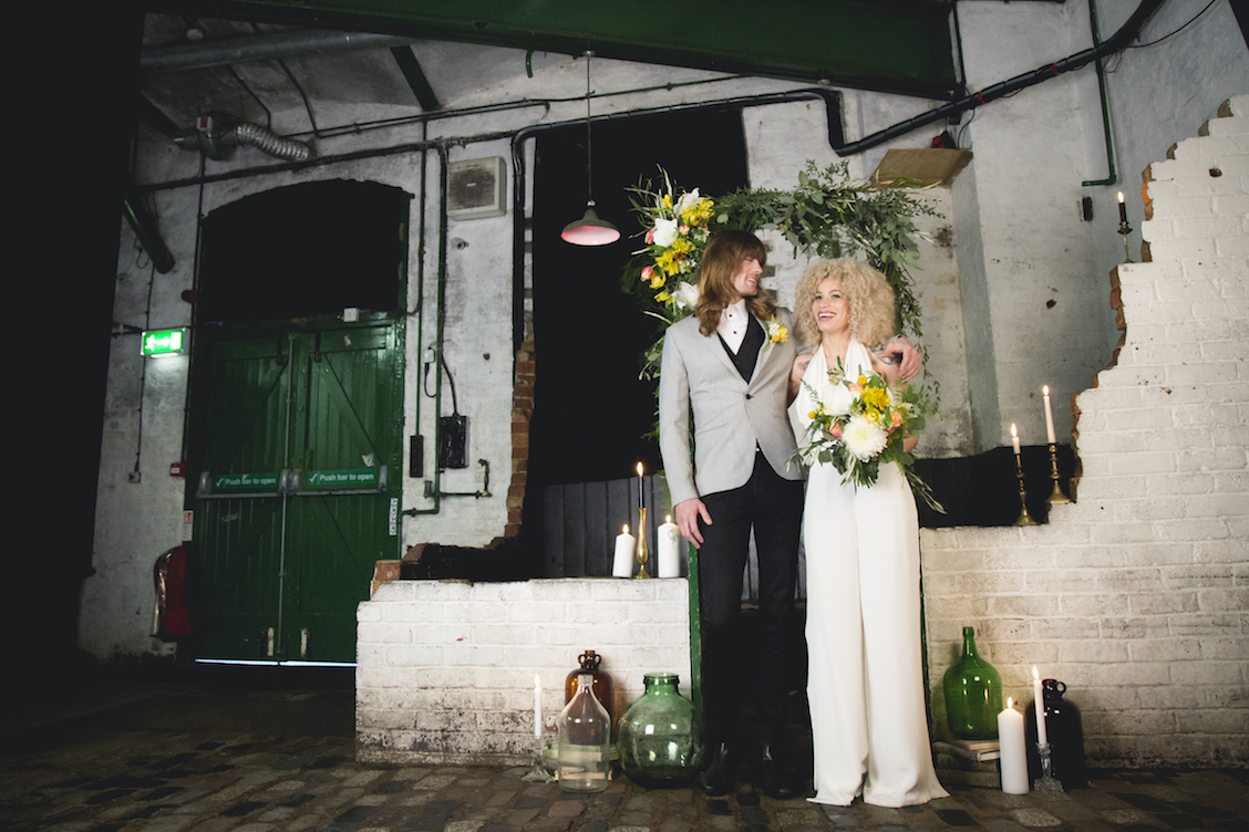 1970's inspired wedding, bride with afro and groom with long hair