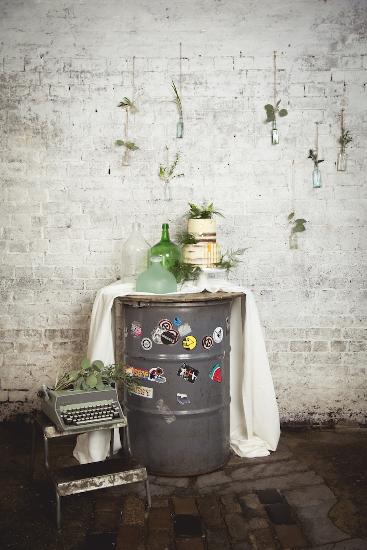industrial oil drum wedding set up, hanging flowers