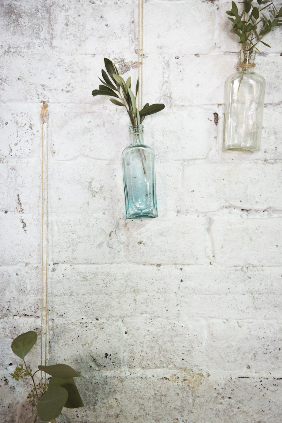 hanging flowers, apothecary bottles with olive foliage