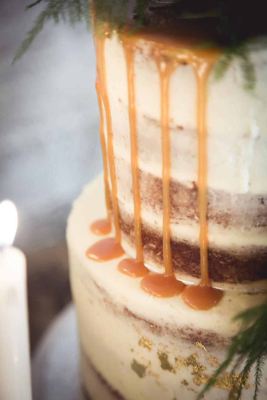naked wedding cake with caramel drips