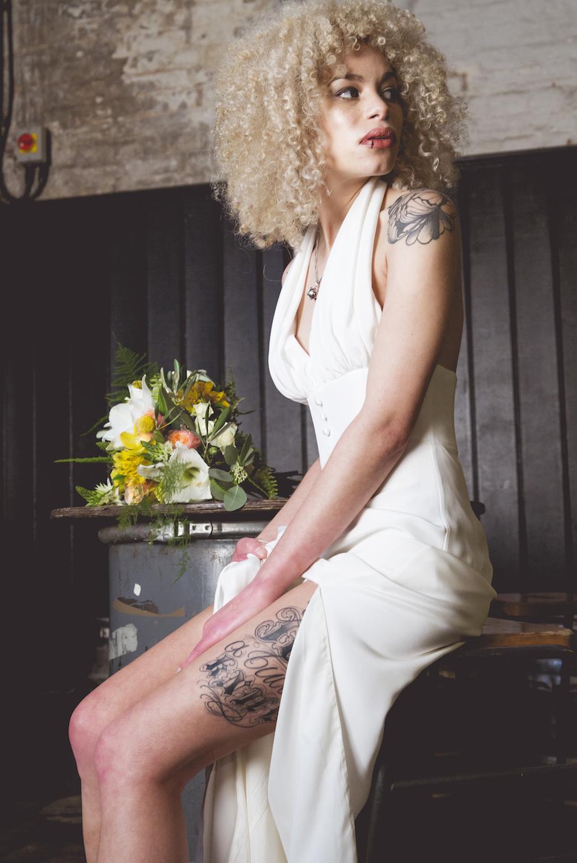 bridal jumpsuit with slit legs, tattoo bride