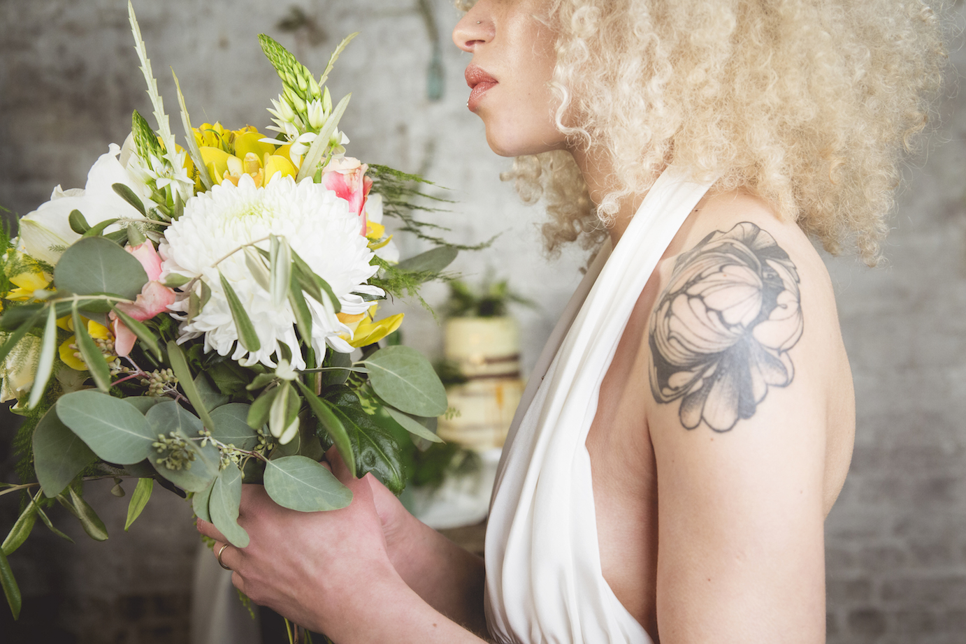 tattooed bride, blonde afro with flowers